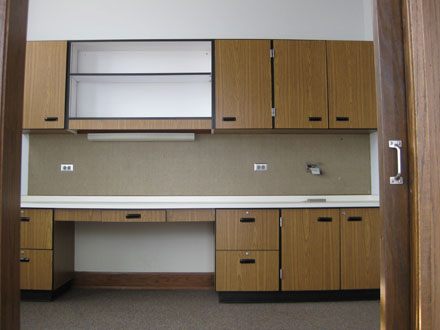 Office 236 has a built in desk and cabinets